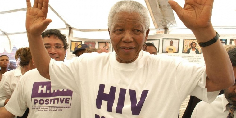 Showing solidarity: Nelson Mandela donned an HIV-Positive T-shirt during a visit to MSF's HIV programme in Khayelitsha in December 2002. Hamba kahle Tata Nelson Mandela © Eric Miller
