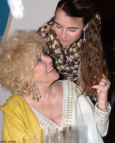 Elizabeth Taylor with her granddaughter Naomi Wilding at a private dinner held in Taylor's honor on March 18, 2003 at the Frederick R. Weisman Art Foundation in Los Angeles, California. Taylor received the first-ever Diamond Icon Award for her courage and leadership in the fight against AIDS. © Dan Steinberg/Getty Images