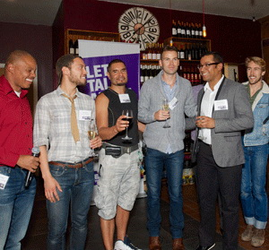 Vincent Fuqua, left, talks with some of the men who attended a recent reception to introduce the new Speak Out social media campaign.