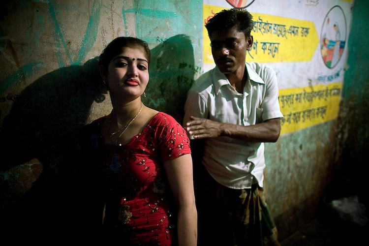 A young chowkri (bonded sex worker) waits for customers on the 3rd floor of the Joinal Bari brothel in Faridpur.