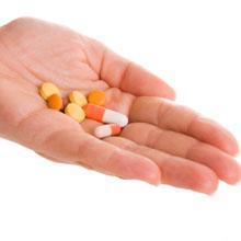 Deutsche AIDS-Hilfe Hand mit Pillen